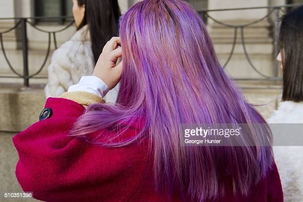Guest seen at Skylight at Moynihan Station outside the Hood By Air show wearing pink coat with purple dyed hair during New York Fashion Week Women's...