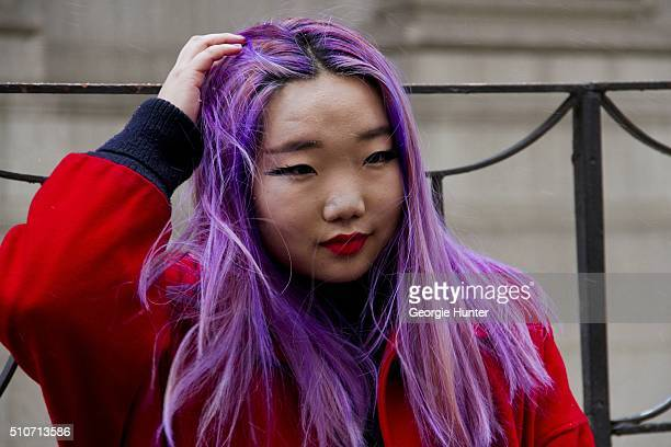 Guest seen at Skylight at Moynihan Station outside the Jeremy Scott show wearing red bomber jacket with purple dyed hair during New York Fashion Week...
