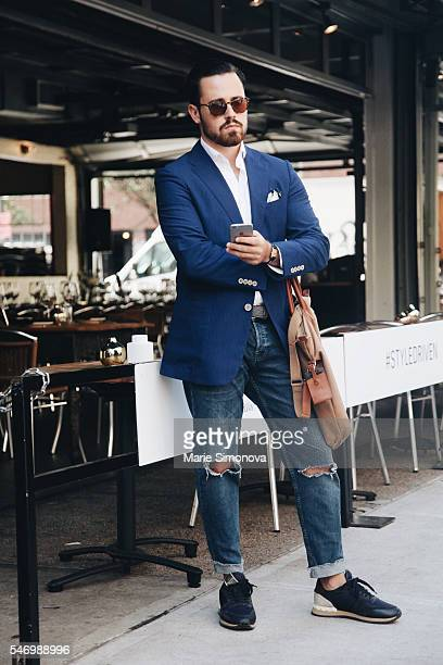 Guest seen before Suitsupply runway show during New York Men's Fashion Week on July 11 2016 in New York City