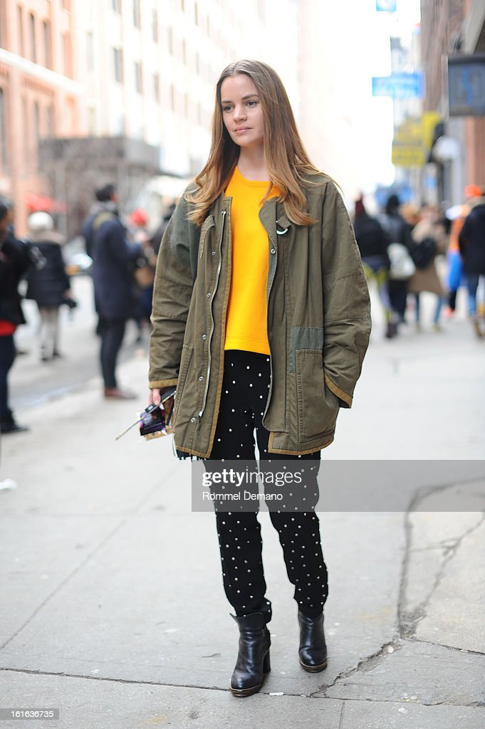 A guest seen outside the Jeremy Scott show wearing a Push Button pants on February 13, 2013 in New York City.