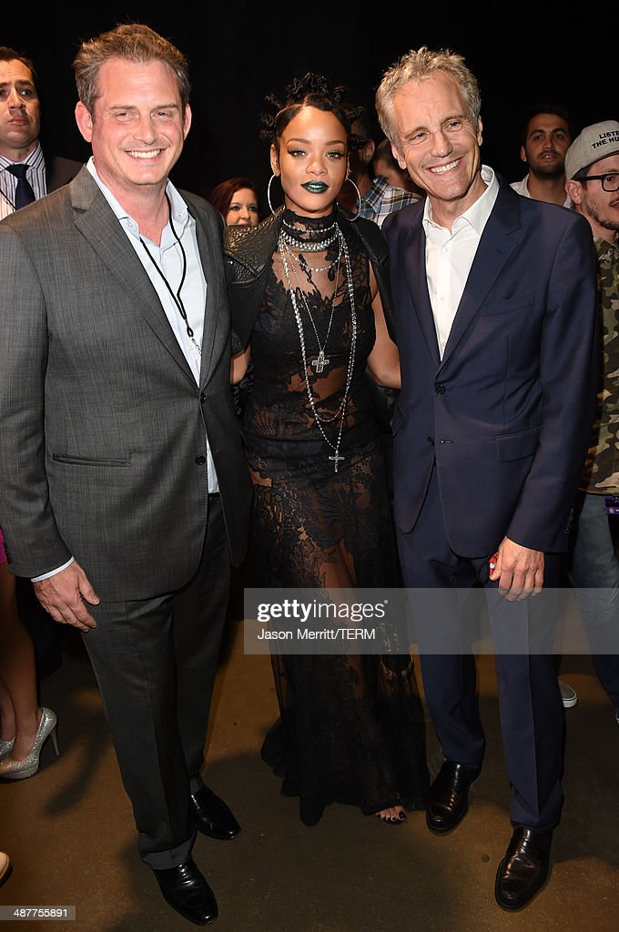 Guest, singer Rihanna and Clear Channel Media Holdings Entertainment Enterprises President John Sykes backstage at the 2014 iHeartRadio Music Awards held at The Shrine Auditorium on May 1, 2014 in Los Angeles, California. iHeartRadio Music Awards are being broadcast live on NBC.