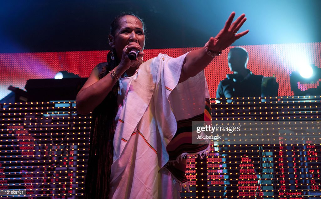 Guest singer Sista Pat (L) and DJ Eric Hilton (R) of the American band Thievery Corporation performs live at the Huxleys Neue Welt on June 6, 2010 in Berlin, Germany.