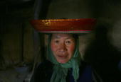 A guest sits in the groom's home during a Tu ethnic minority group wedding ceremony of Qi Xinghe and his bride Luo Jinhua on January 30 2007 in Huzhu...