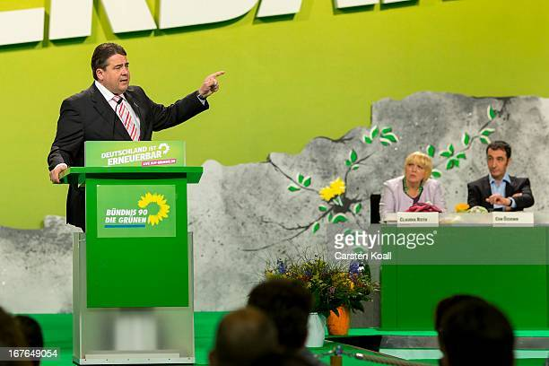 Guest speaker SPD Chairman Sigmar Gabriel gestures during his speach to German Greens cochairwoman Claudia Roth German Greens Party and cochairman...