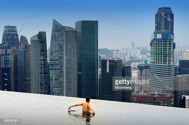 A guest swims in the Skypark pool atop Las Vegas Sands Corp's Marina Bay Sands integrated resort and casino in Singapore on Wednesday July 28 2010...