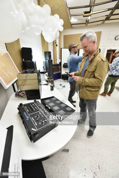 A guest takes a picture of the last working Resynator during it's unveiling at Sound City Studios on November 2 2017 in Van Nuys California