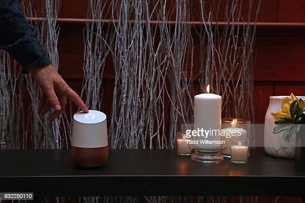 A guest touches a Google Home at the Google Home Sundance dinner on January 20 2017 in Park City Utah
