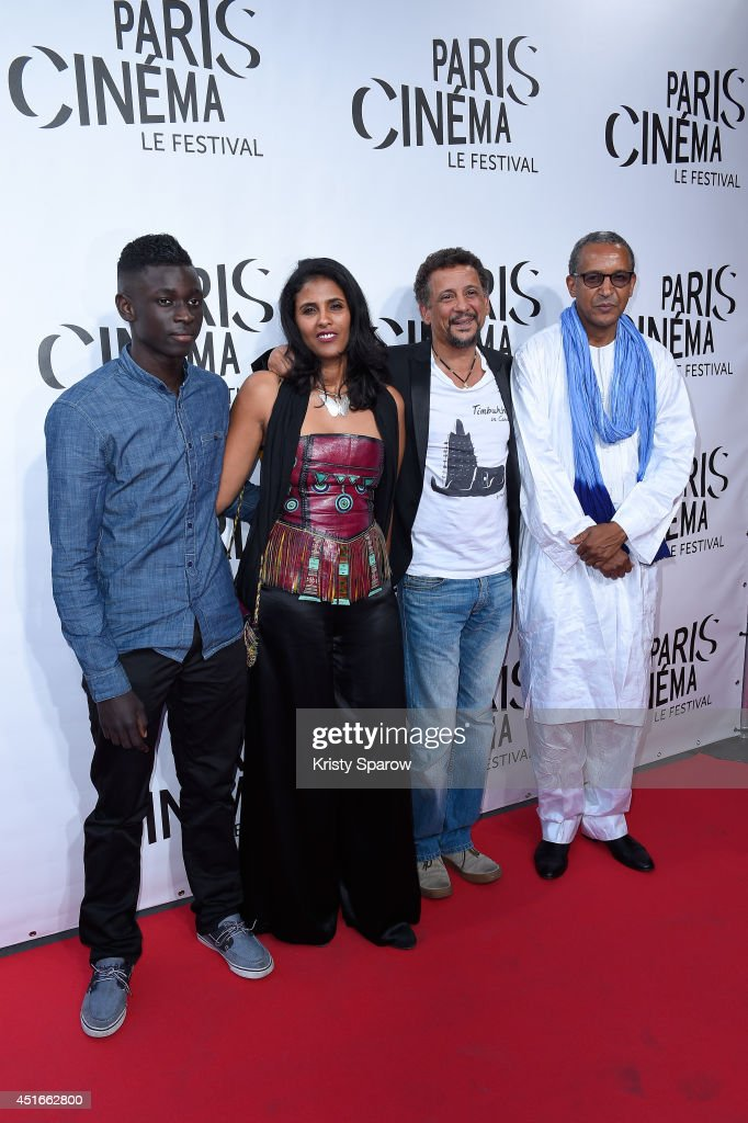 Guest, <a gi-track='captionPersonalityLinkClicked' href=/galleries/search?phrase=Toulou+Kiki&family=editorial&specificpeople=12811020 ng-click='$event.stopPropagation()'>Toulou Kiki</a>, <a gi-track='captionPersonalityLinkClicked' href=/galleries/search?phrase=Abel+Jafri&family=editorial&specificpeople=598715 ng-click='$event.stopPropagation()'>Abel Jafri</a> and <a gi-track='captionPersonalityLinkClicked' href=/galleries/search?phrase=Abderrahmane+Sissako&family=editorial&specificpeople=618403 ng-click='$event.stopPropagation()'>Abderrahmane Sissako</a> attend the Festival Paris Cinema Opening Ceremony at Cinema Gaumont Capucine on July 3, 2014 in Paris, France.