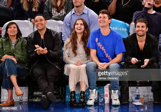 Guest Trevor Noah Violetta Komyshan Ansel Elgort and Paul Wesley attend Houston Rockets Vs New York Knicks game at Madison Square Garden on October 9...
