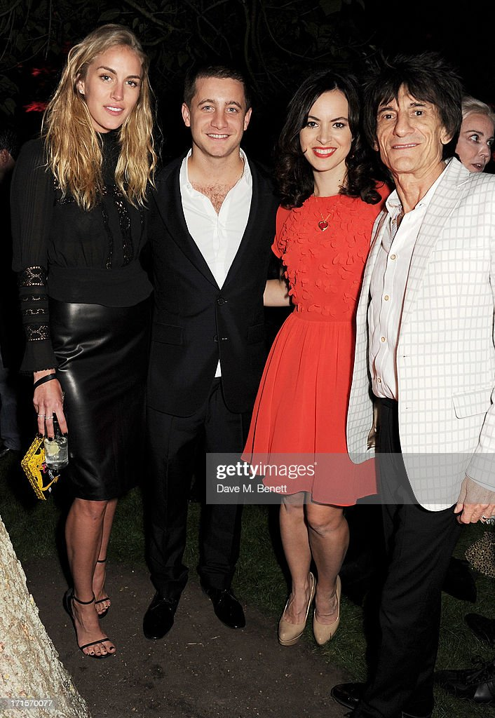 Guest, Tyrone Wood, Sally Humphries and Ronnie Wood attend the annual Serpentine Gallery Summer Party co-hosted by L'Wren Scott at The Serpentine Gallery on June 26, 2013 in London, England.