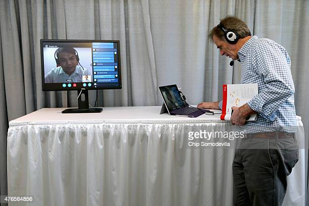 A guest uses Skype and Microsoft automatic translation software to livechat with a man in China during the Microsoft Innovation and Policy Center's...