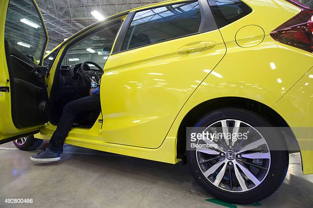A guest views the interior of a Honda Motor Co Fit subcompact vehicle at the company's transmission plant in Celaya Mexico on Thursday Oct 8 2015 The...