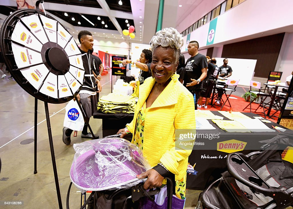 A guest visits the Denny's table at FAN FEST during the 2016 BET Experience on June 25, 2016 in Los Angeles, California.