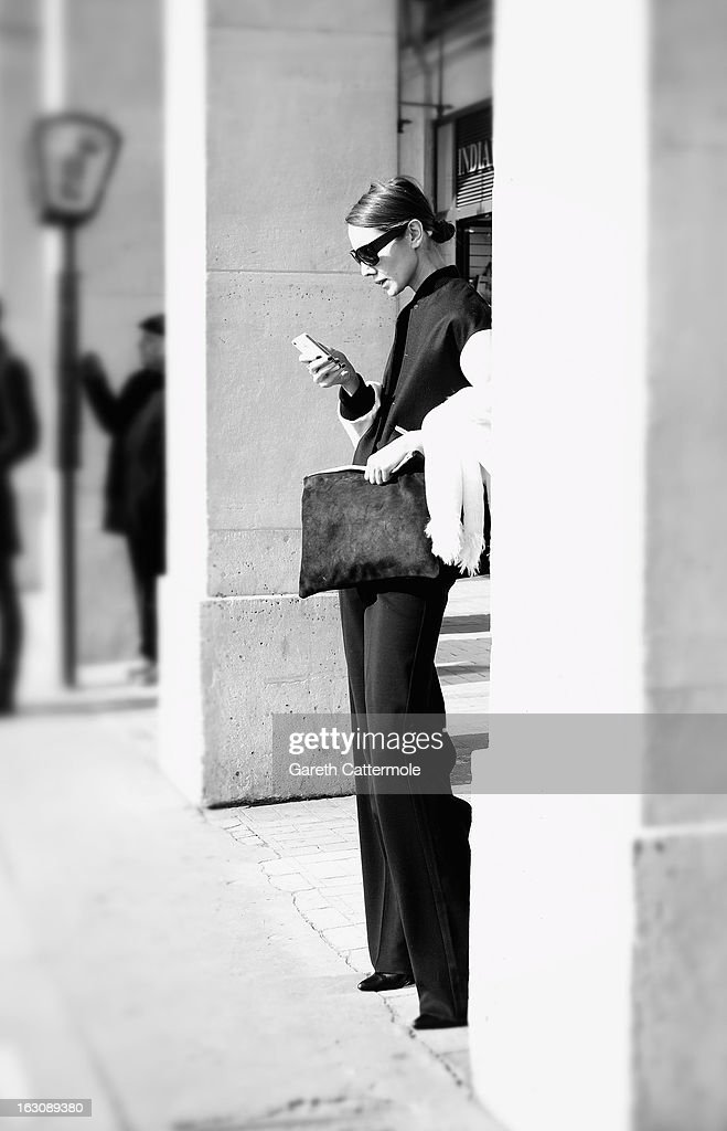 A guest waits outside a fashion show during Paris Fashion Week on March 4, 2013 in Paris, France.