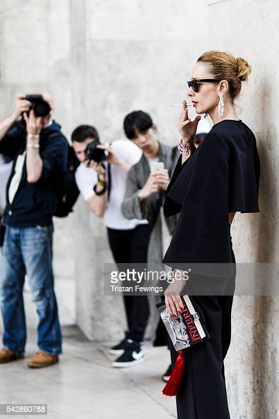 A guest waits outside the Palais de Tokyo ahead of the 22/4 Menswear Spring/Summer show as part of Paris Fashion Week on June 22 2016 in Paris France