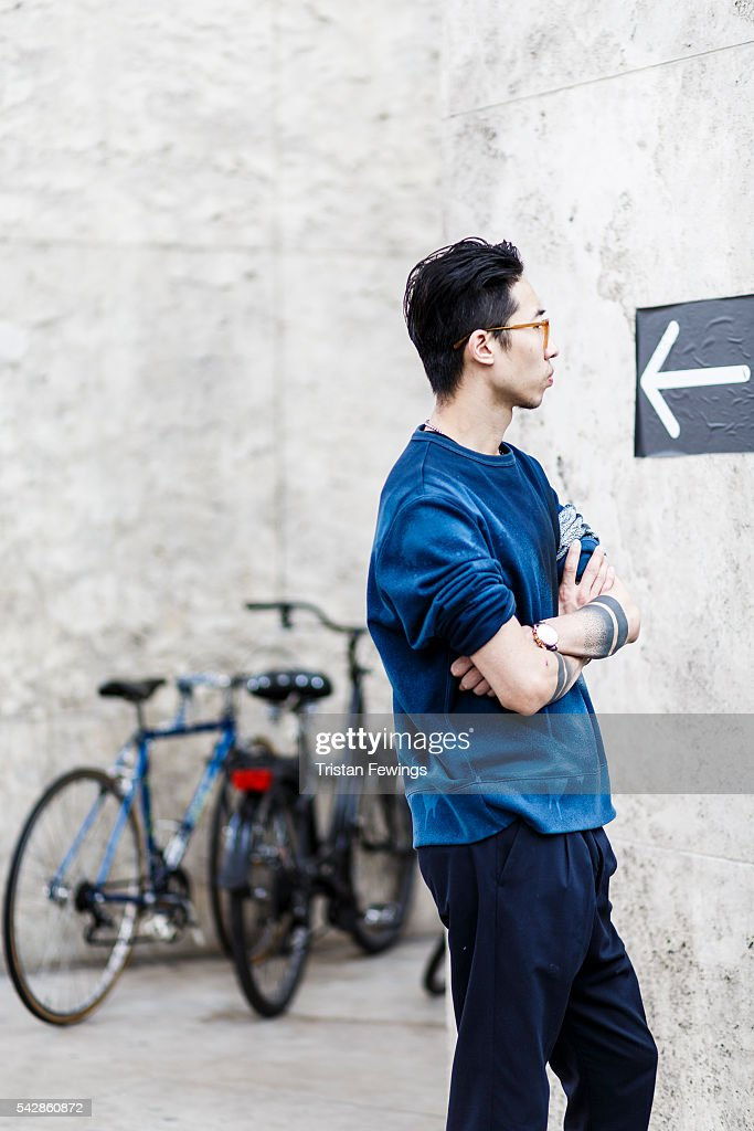 A guest waits outside the Palais de Tokyo ahead of the 22/4 Menswear Spring/Summer show as part of Paris Fashion Week on June 22, 2016 in Paris, France.