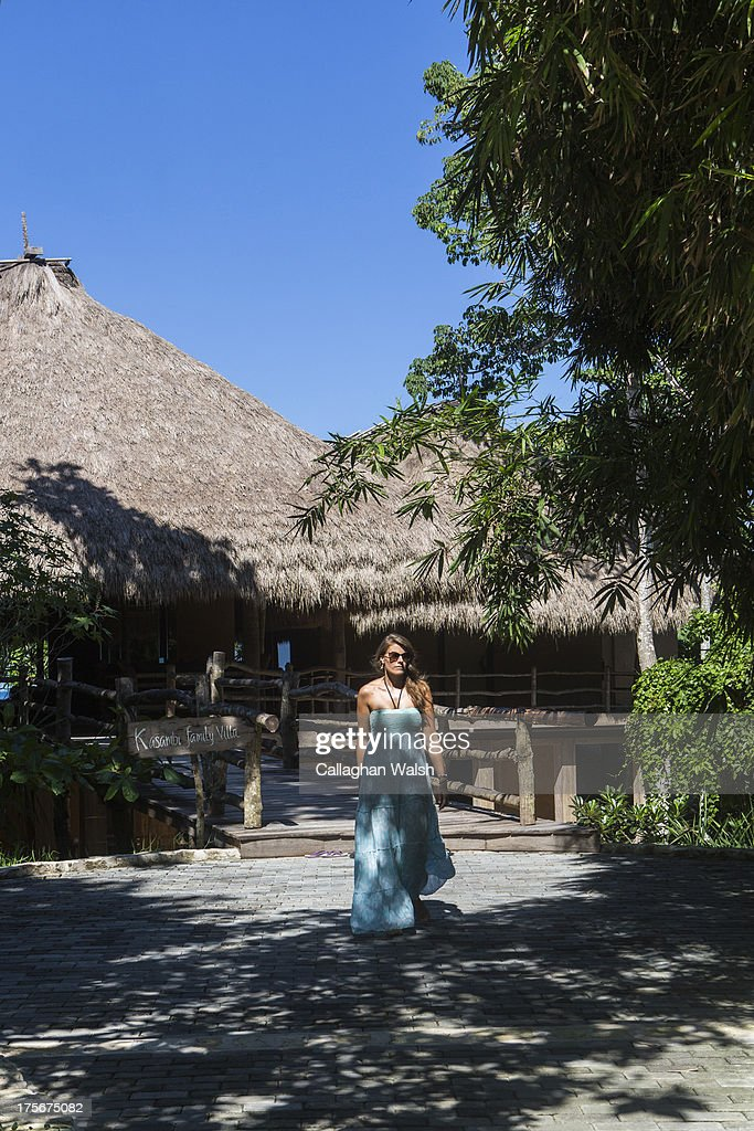A guest walks from the Kasambi Family Villa at Nihiwatu Resort, Western Sumba on April 14, 2013. Sumba is a remote island in Eastern Indonesia, part of the Lesser Sunda Islands group based in the province of East Nusa Tenggara.