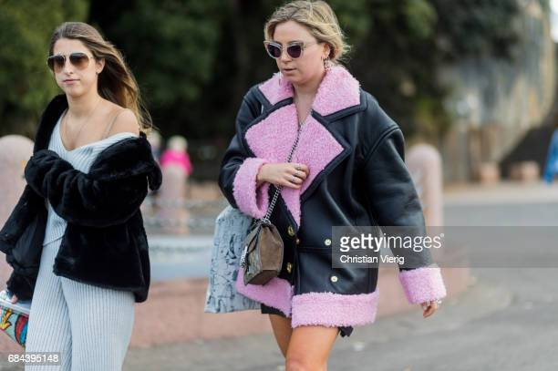 A guest wearing a a jacket with pink fake fur collar outside Dyspnea at day 5 during MercedesBenz Fashion Week Resort 18 Collections at Sydney Opera...