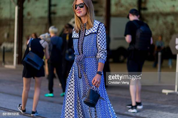 A guest wearing a baby blue dress outside By Johnny at MercedesBenz Fashion Week Resort 17 Collections at Carriageworks on May 17 2016 in Sydney...