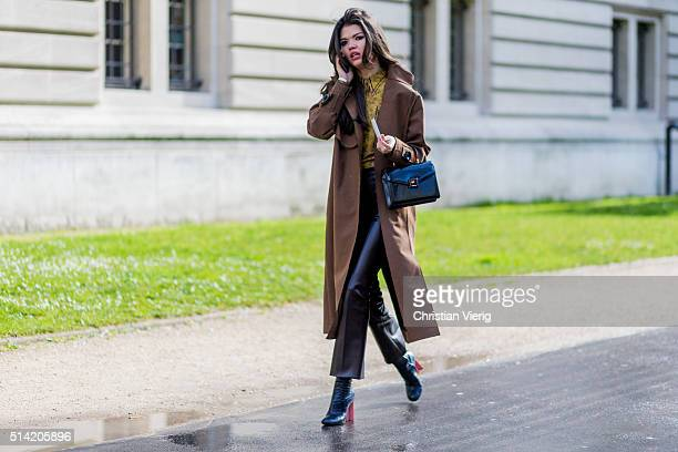 A guest wearing a brown wool coat and black leather pants outside Giambattista Valli during the Paris Fashion Week Womenswear Fall/Winter 2016/2017...
