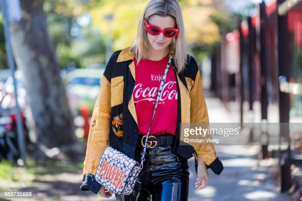 A guest wearing a Coca Cola tshirt latex pants at day 3 during MercedesBenz Fashion Week Resort 18 Collections at Carriageworks on May 16 2017 in...