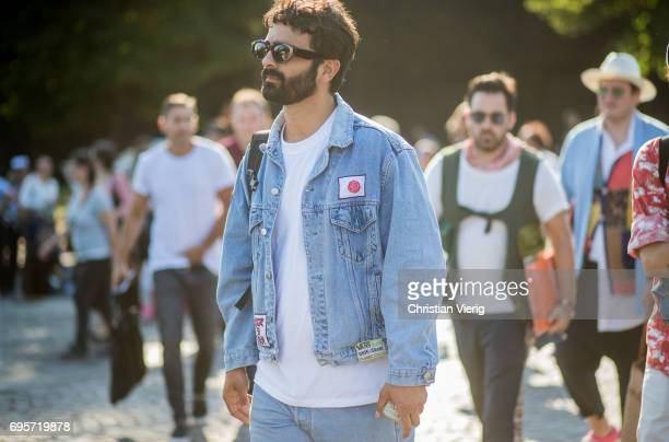 A guest wearing a denim jacket is seen during Pitti Immagine Uomo 92 at Fortezza Da Basso on June 13 2017 in Florence Italy