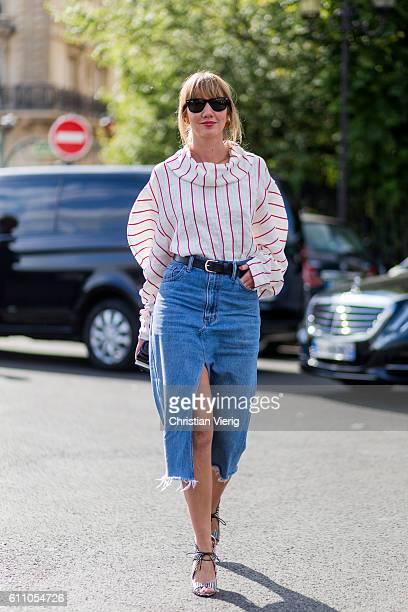 A guest wearing a denim skirt outside Dries van Noten on September 28 2016 in Paris France