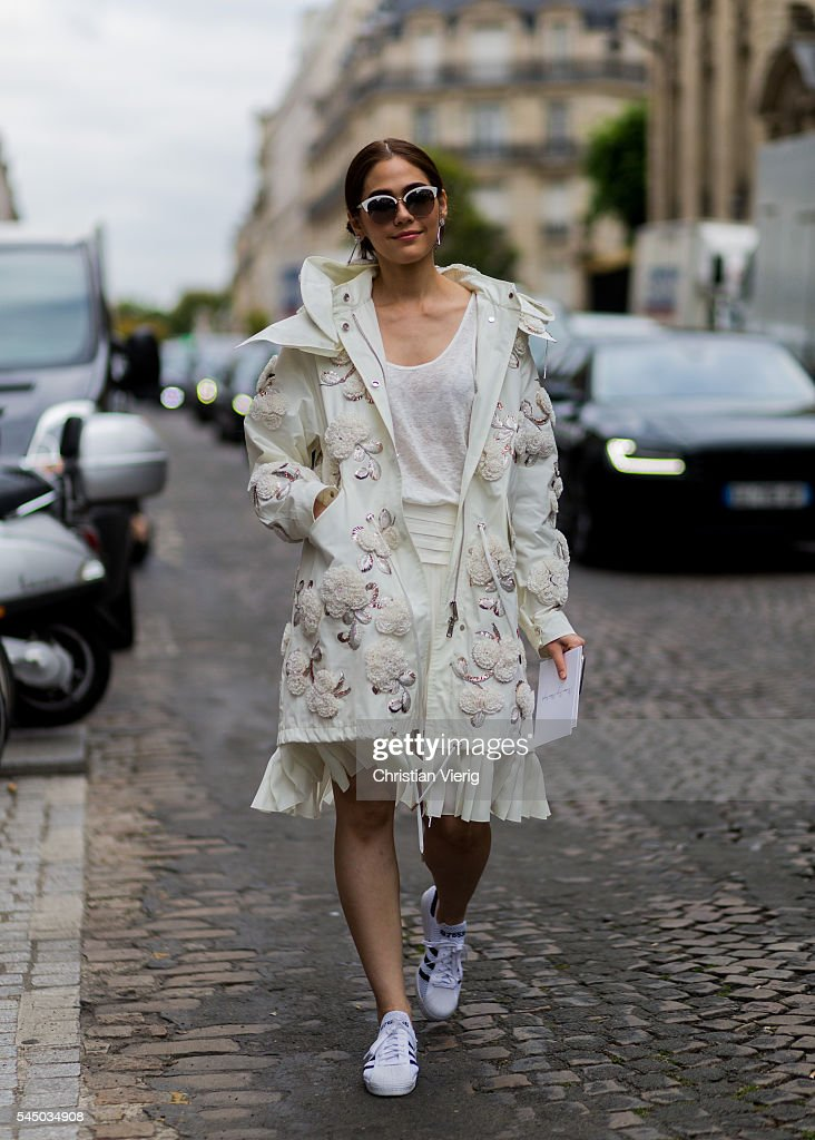 A guest wearing a Dior coat outside Dior during Paris Fashion Week Haute Couture F/W 2016/2017 on July 4 2016 in Paris France