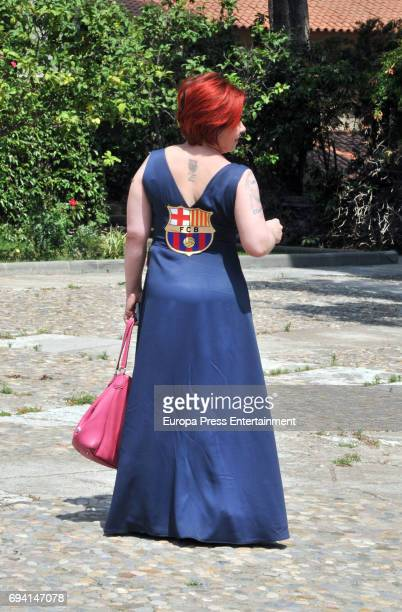 A guest wearing a dress with Barcelona fooball club emblem attends the wedding of the goalkeeper Victor Valdes and Yolanda Cardona on June 9 2017 in...