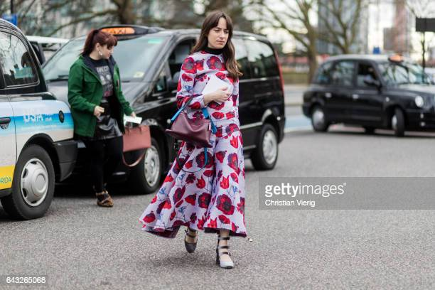 A guest wearing a dress with floral print outside Christopher Kane on day 4 of the London Fashion Week February 2017 collections on February 20 2017...