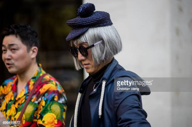 A guest wearing a flat cap outside OAMC during Paris Fashion Week Menswear Spring/Summer 2018 on June 21 2017 in Paris France