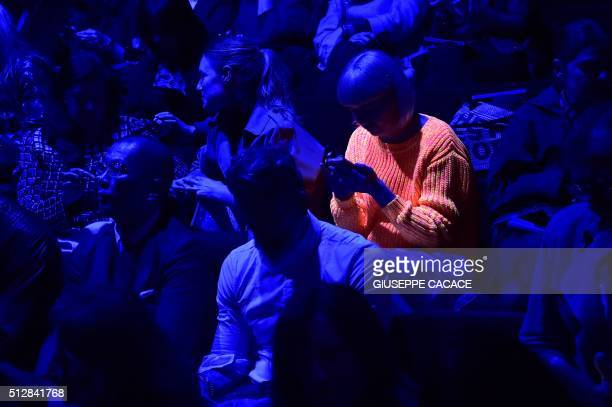 A guest wearing a fluorescent sweater is seen in the audience before the show for fashion house Dolce Gabbana as part of the Women Autumn / Winter...