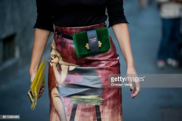 A guest wearing a green Prada bag is seen outside Prada during Milan Fashion Week Spring/Summer 2018 on September 21 2017 in Milan Italy