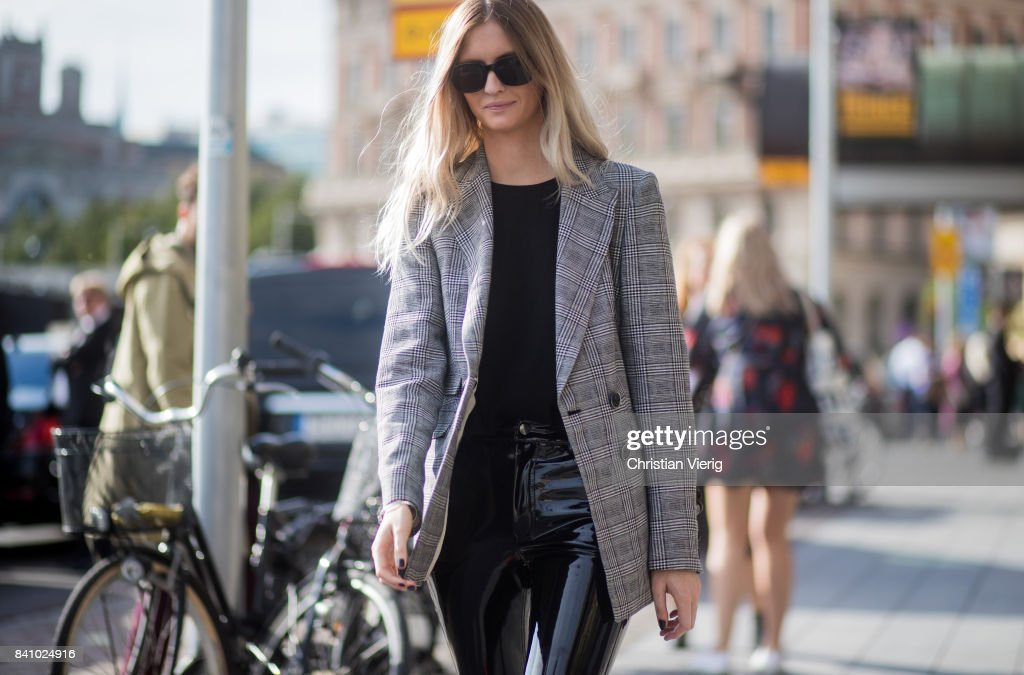 A guest wearing a grey blazer jacket, PVC pants outside By Malina on August 30, 2017 in Stockholm, Sweden.