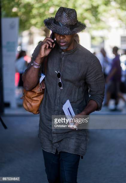 A guest wearing a grey linen button shirt and hat is seen outside Neil Barrett during Milan Men's Fashion Week Spring/Summer 2018 on June 17 2017 in...