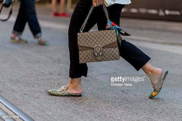 A guest wearing a Gucci bag and slippers outside Misha Collection at MercedesBenz Fashion Week Resort 17 Collections at Carriageworks on May 16 2016...
