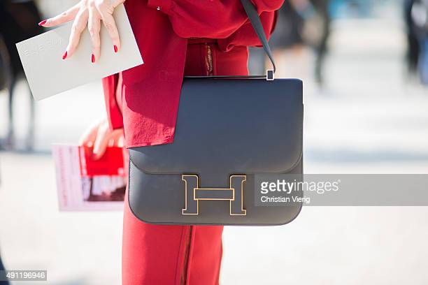 A guest wearing a Hermes bag during the Paris Fashion Week Womenswear Spring/Summer 2016 on October 3 2015 in Paris France