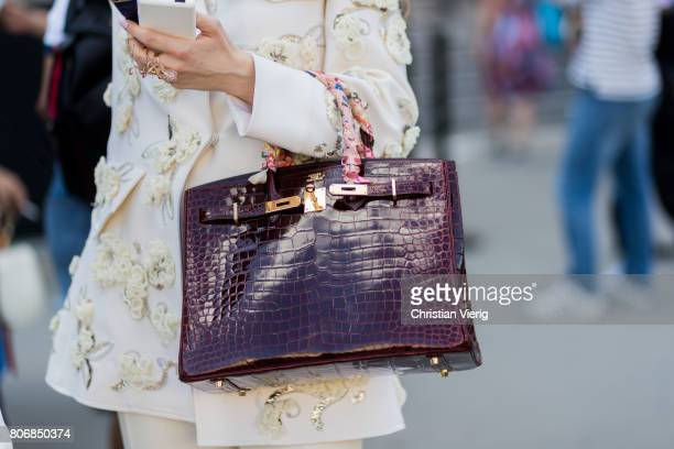 A guest wearing a Hermes bag outside Ralph Russo during Paris Fashion Week Haute Couture Fall/Winter 20172018 Day Two on July 3 2017 in Paris France