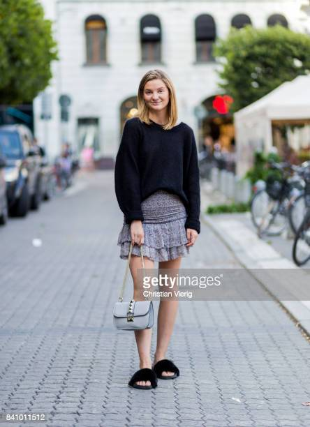 A guest wearing a knit skirt sandals Valentino bag outside Busnel on August 30 2017 in Stockholm Sweden