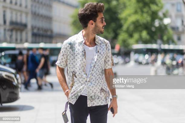 A guest wearing a Louis Vuitton button shirt outside Louis Vuitton during Paris Fashion Week Menswear Spring/Summer 2018 on June 22 2017 in Paris...