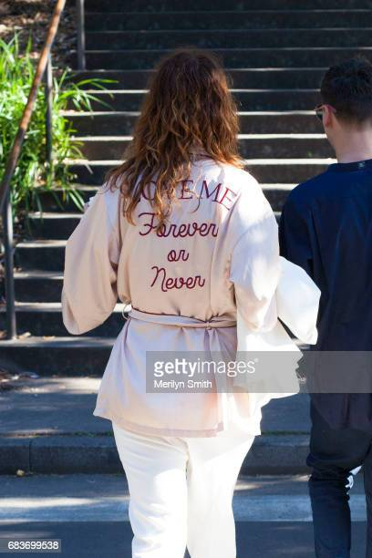 Guest wearing a Love Me Forever or Never bomber jacket during MercedesBenz Fashion Week Resort 18 Collections at Carriageworks on May 16 2017 in...