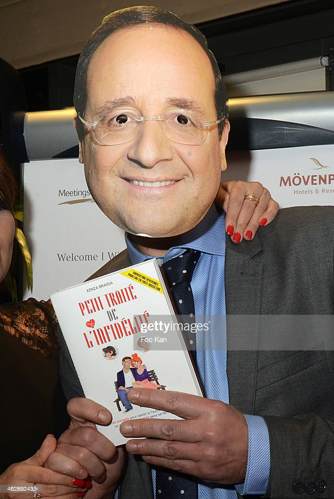 A guest wearing a mask of Francois Hollande attends the 'Petit Traite De L'Infidelite' (Little Treatise About Infidelity) Kenza Braiga Book Launch Cocktail hosted by Gleeden.com at the Movenpick Paris Neuilly on January 15, 2014 in Paris, France.