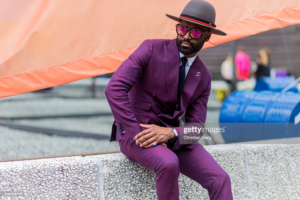 A guest wearing a purple hat during Pitti Uomo 90 on June 14, 2016, in Florence, Italy