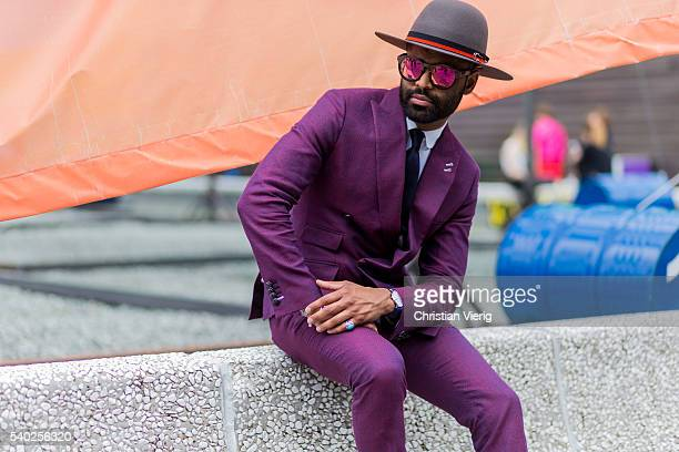 A guest wearing a purple hat during Pitti Uomo 90 on June 14 in Florence Italy