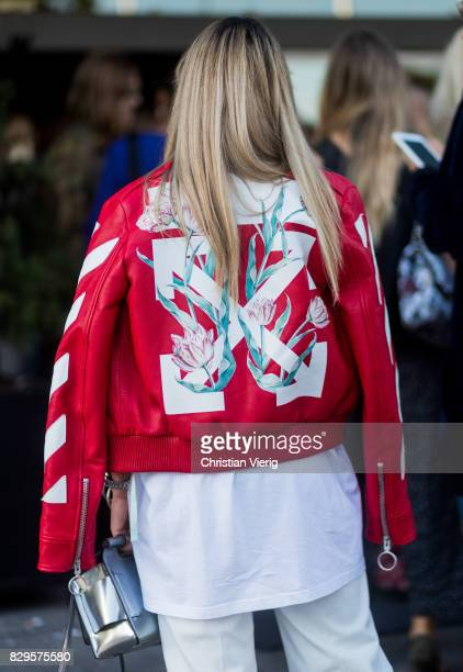 A guest wearing a red Off White leather jacket outside Saks Potts on August 10 2017 in Copenhagen Denmark
