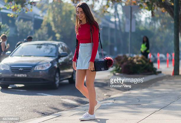 SYDNEY AUSTRALIA MAY 19 A guest wearing a red sweater mini skirt and black Chanel bag with Fendi fur ball at MercedesBenz Fashion Week Resort 17...