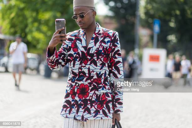 A guest wearing a shirt with floral print is seen during Pitti Immagine Uomo 92 at Fortezza Da Basso on June 14 2017 in Florence Italy