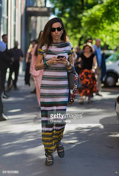 A guest wearing a striped dress outside Fendi during the Milan Men's Fashion Week Spring/Summer 2017 on June 20 2016 in Milan Italy