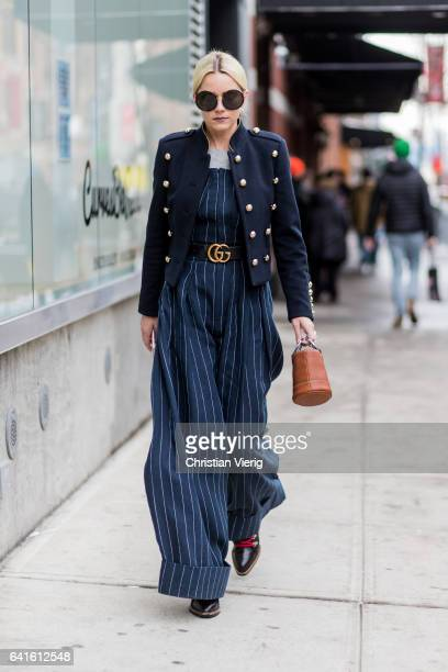 A guest wearing a striped overall blazer jacket Gucci belt outside Tibi on February 11 2017 in New York City