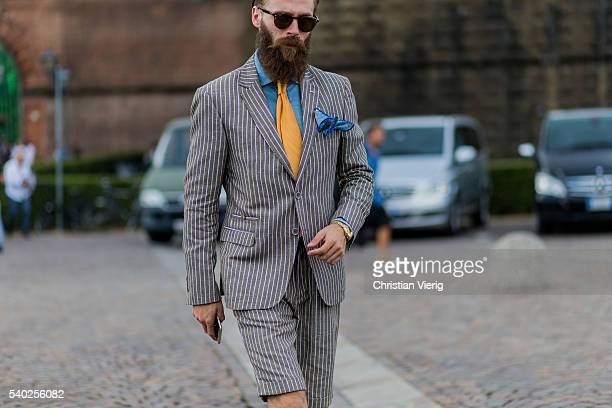 A guest wearing a striped suit during Pitti Uomo 90 on June 14 in Florence Italy